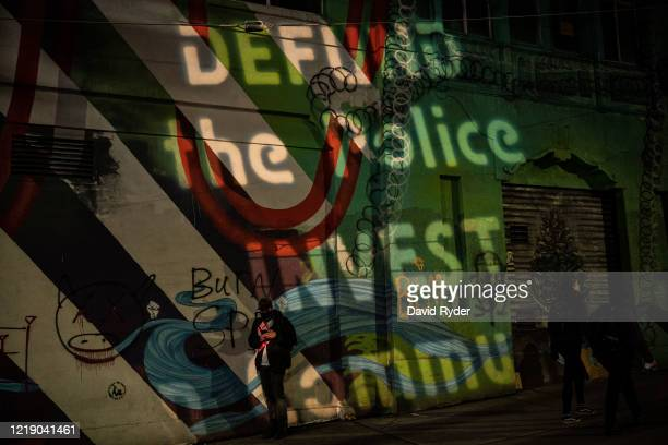 Projected message is seen on a wall near the Seattle Police Departments East Precinct on June 9, 2020 in Seattle, Washington. Protests have continued...