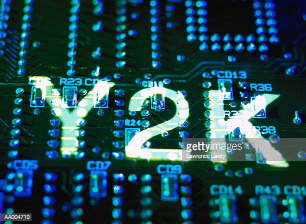 y2k projected on a computer circuit board - 西暦2000年 ストックフォトと画像