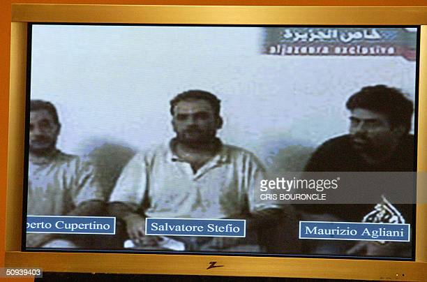 Projected on a screen during a press conference from left to right Umberto Cupertino Salvatore Stefio and Maurizio Agliana are seen as Polish...