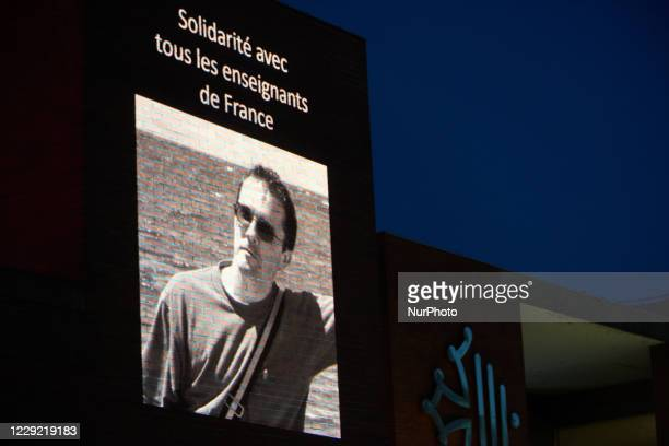 Projected picture on the Regional Council building of Samuel Paty reading 'solidarity with all teachers of France'. 'After the killing of Samuel...