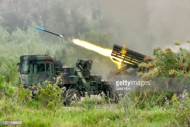 Projectile is launched from a Taiwanese-made Thunderbolt-2000 multiple rocket system during the annual Han Kuang military drills in Taichung on July...