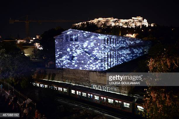 A projection by a Greek artist Aemilia Papaphilippou titled 'pulsating fields' is projected at the Stoa of Attalos at the ancient agora in Athens on...