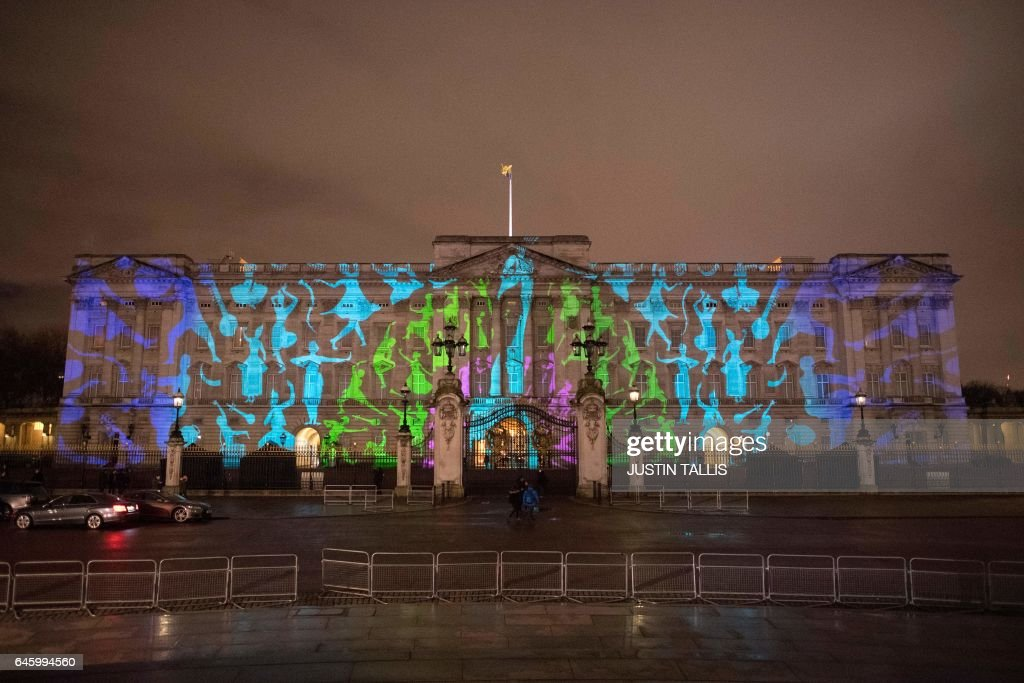 A projection commissioned to mark the start of the UK-India Year of Culture depicting India's national bird, the peacock, is seen on the exterior of Buckingham Palace in London on February 27, 2017. / AFP / Justin TALLIS