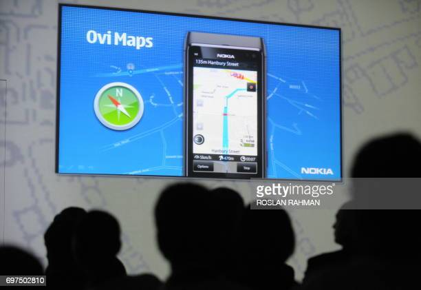 A projection displays application features on the latest Nokia N8 Smartphone during its launch in Singapore on June 14 2010 AFP PHOTO/ROSLAN RAHMAN