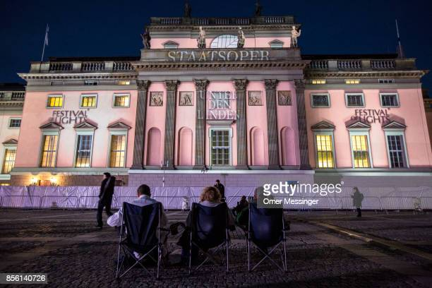 Projection is seen on the Berlin State Opera Unter den Linden after a concert conducted by Daniel Barenboim leads musicians and singers in a free,...