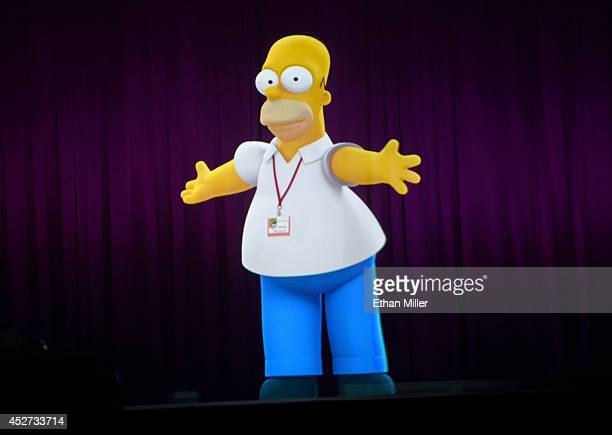 A projection of Homer Simpson is shown during FOX's The Simpsons panel during ComicCon International 2014 at the San Diego Convention Center on July...