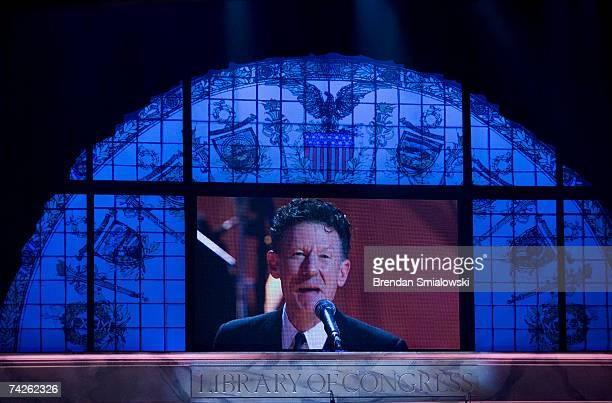 A projection of Lyle Lovett is shown while he performs during the Library Of Congress Gershwin Prize For Popular Song Gala at the Warner Theater May...