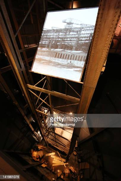 Projection of the Harland and Wolff shipyard sits atop a recreation of the Arrol Gantry at the Titanic Belfast visitor attraction on March 27, 2012...