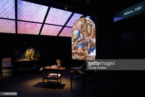 A projection of the painting 'The Virgin of the Rocks' by Leonardo da Vinci is seen in a reimagined studio room during a photocall for the upcoming...