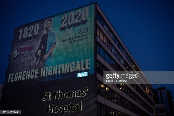 A projection on the side of St Thomas Hospital marks the 200th anniversary of Florence Nightingale a pioneer of modern nursing on May 11 2020 in...