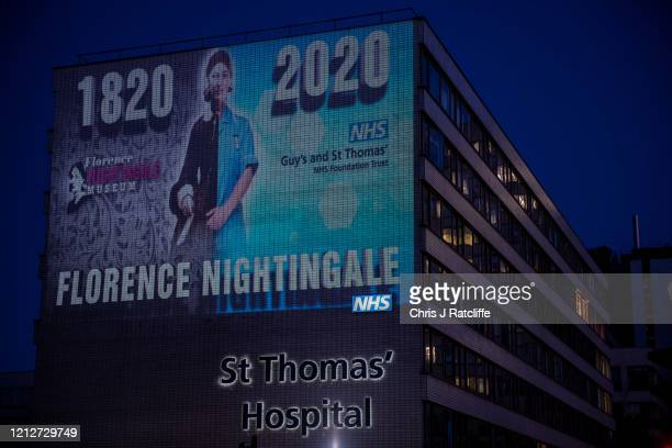 Projection on the side of St. Thomas Hospital marks the 200th anniversary of Florence Nightingale, a pioneer of modern nursing, on May 11, 2020 in...