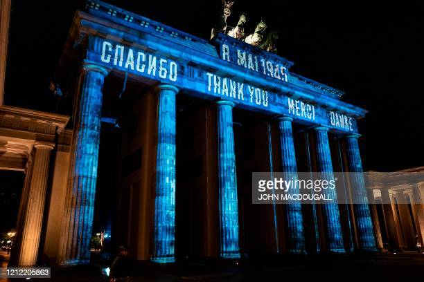 A projection reading thank You in Russian English French and German is projected on Berlin's Brandenburg Gate on May 8 on the 75th anniversary of the...