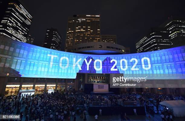 A projection that reads Tokyo 2020 is seen during a ceremony marking three years to go before the start of the Tokyo 2020 Olympic games at the Tokyo...