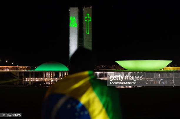 Projection to pay homage to the mre than 20,000 victims of Covid-19 is seen at the Brazilian National Congress Building amidst the coronavirus...