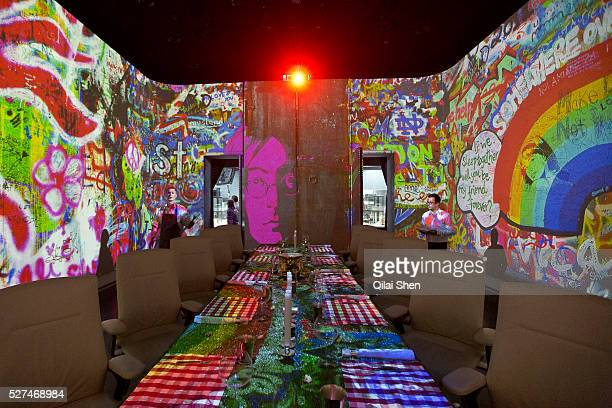 Projections adorn the dining room wall of Chef Paul Pairet's Ultra Violet restaurant in Shanghai, China on 28 September 2013. Serving only a dozen...