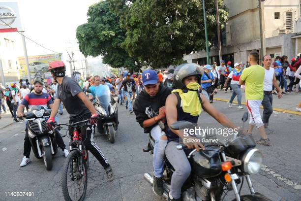 ProJuan Guaidó supporters protest after the May 1 demonstration at Plaza Altamira on May 1 2019 in Caracas Venezuela Yesterday Venezuelan opposition...