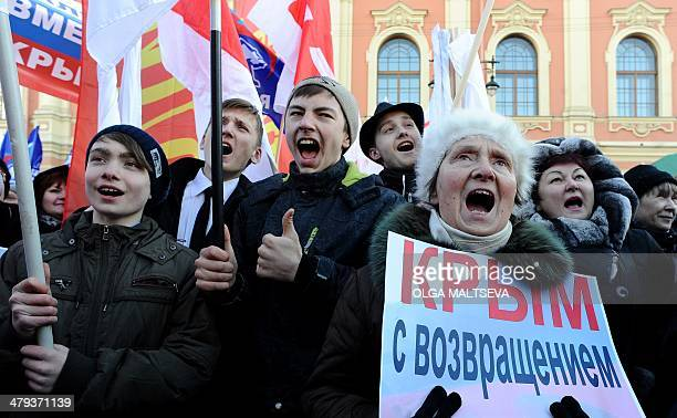 ProKremlin activists rally in Russia's second city of St Petersburg on March 18 to celebrate the incorporation of Crimea The poster reads 'Welcome...