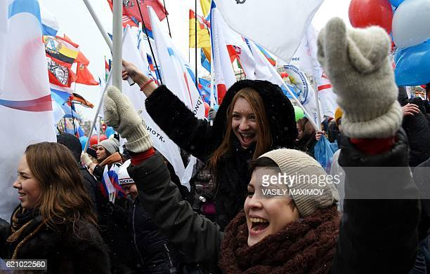 ProKremlin supporters march in central Moscow on November 4 2016 as they celebrate the National Unity Day marking the 404th anniversary of the 1612...