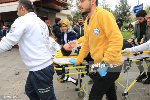 ProKurdish Peoples' Democratic Party lawmaker Remziye Tosun carried by emergency service after being hit by a police water cannon during a protest...