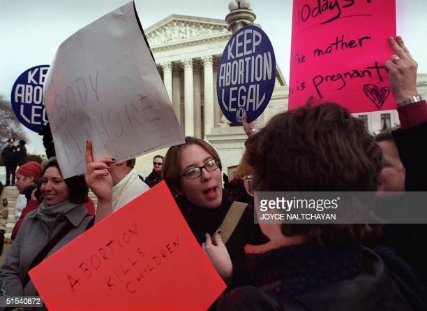 A prolife activist and a prochoice activist confront one another in front of the US Supreme Court 24 January 2000 during the annual March For Life...
