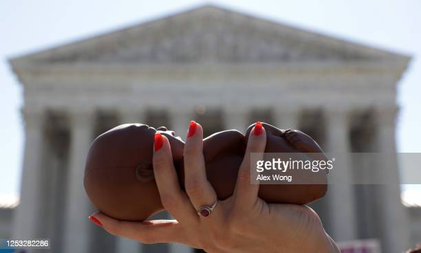 Pro-life activist holds a model fetus during a demonstration in front of the U.S. Supreme Court June 29, 2020 in Washington, DC. The Supreme Court...