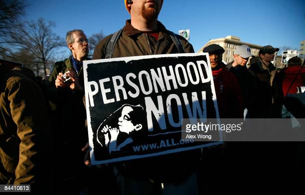 A prolife activist holds a sign as he participates in the annual 'March for Life' event January 22 2009 in Washington DC The event was to mark the...