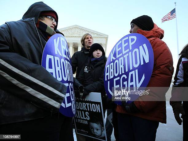 Prolife activists Gina Fazenbaker of Clarion Pennsylvania and Patrick Elms of Raleigh North Carolina discuss the abortion issue with prochoice...