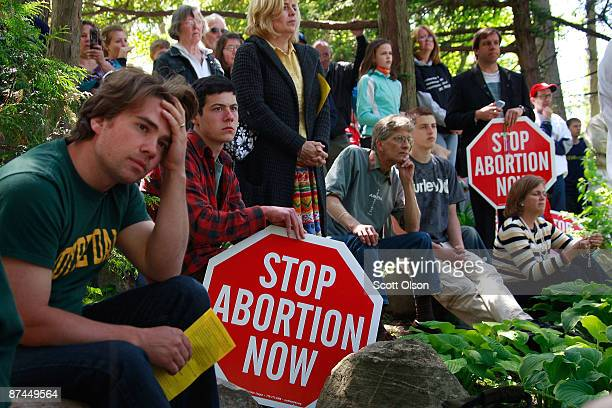 Pro-life activists look on as Notre Dame University students hold an alternative commencement cermony held to protest President Barack Obama's visit...