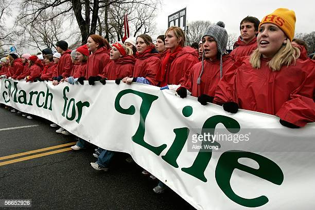 ProLife activists march up Constitution Ave towards the US Supreme Court during the annual March for Life event January 23 2006 in Washington DC The...