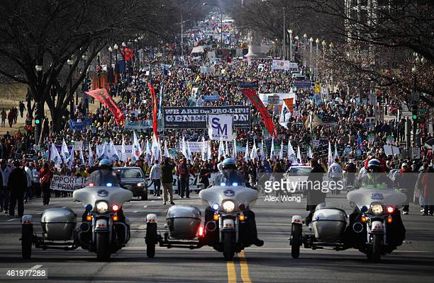Pro-life activists participate in the annual March for Life as they march up Constitution Avenue January 22, 2015 in Washington, DC. Pro-life...
