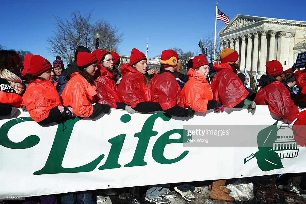 Pro-life activists participate in the annual March for Life in front of the U.S. Supreme Court January 22, 2014 on Capitol Hill in Washington, DC. Activists from all around the country gathered in Washington for the event to protest the Roe v. Wade Supreme Court decision in 1973 that helped to legalize abortion in the United States.