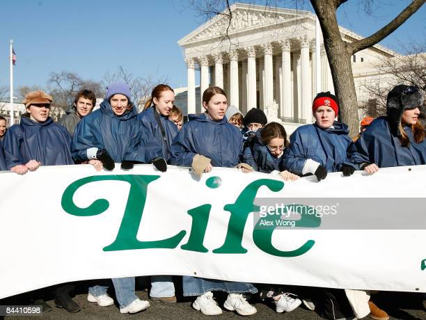 Prolife activists pass by the US Supreme Court as they participate in the annual 'March for Life' event January 22 2009 in Washington DC The event...