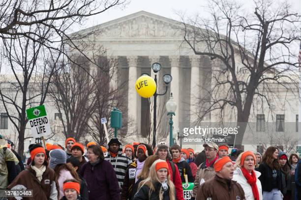 Prolife activists stand near the US Supreme Court at the March for Life rally on January 23 2012 in Washington DC Prolife activists gather each year...