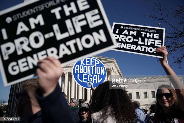 Prolife activists try to block the sign of a prochoice activist during the 2018 March for Life January 19 2018 in Washington DC Activists gathered in...