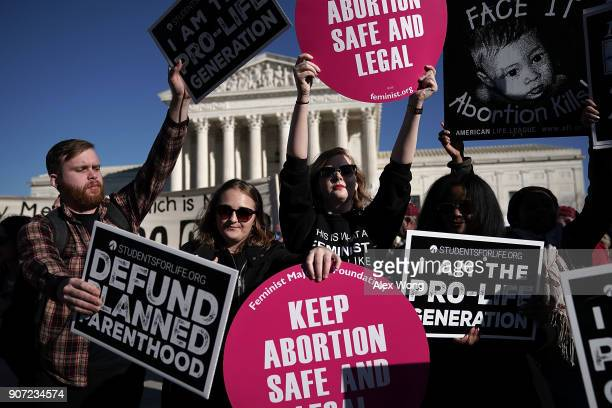 Prolife activists try to block the signs of prochoice activists in front of the the US Supreme Court during the 2018 March for Life January 19 2018...