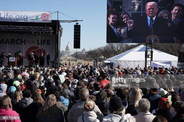 Prolife activists watch US President Donald Trump giving remarks from the Rose Garden of the White House on a jumbotron during a rally at the...