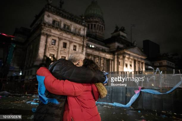 Prolife demonstrators celebrate following a protest outside of the National Congress building in Buenos Aires Argentina early on Thursday Aug 9 2018...