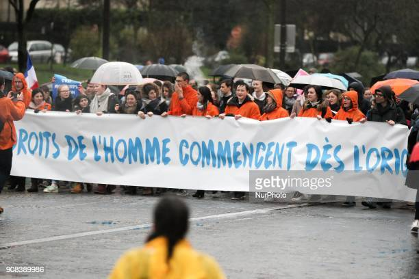 Prolife demonstrators hold banner reading Human rights begin from the origins during a March for life demonstration in Paris on January 21 against...