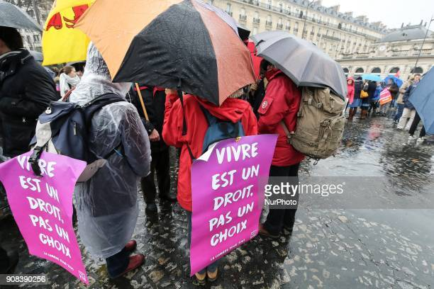 Prolife demonstrators hold signs reading Living is a right not a choice during a March for life demonstration in Paris on January 21 against abortion...