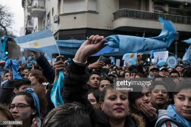 Prolife demonstrators wave flags during a protest outside of the National Congress building in Buenos Aires Argentina on Wednesday Aug 8 2018...