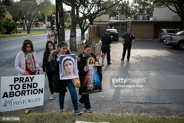Pro-life demonstrators, who declined to give their names, protest outside Whole Woman's Health of McAllen and try to convince women to seek abortion...