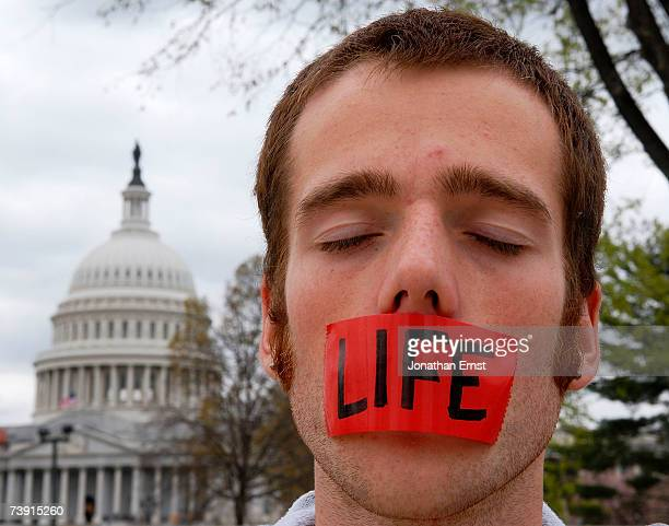 Prolife protester Caleb Brown prays outside the Supreme Court building April 18 2007 in Washington DC The Court today in a 54 ruling upheld a federal...