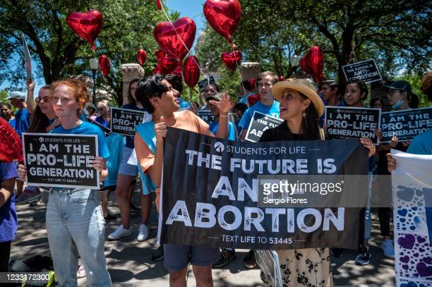 Pro-life protesters stand near the gate of the Texas state capitol at a protest outside the Texas state capitol on May 29, 2021 in Austin, Texas....