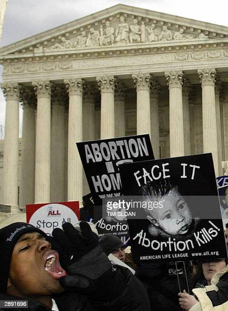 A prolife supporter leads a cheer in front of the US Supreme Court during the March for Life demonstration 22 January in Washington DC US President...
