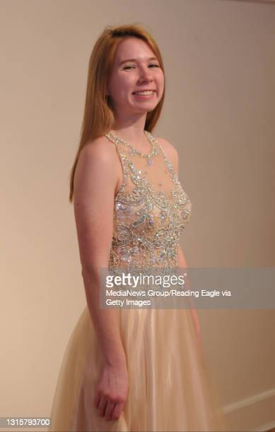 Prom Fashions at Bella Jules Wyomissing High School Senior Kenzie Holt models a nude dress with peek-a-boo cut-outs and silver embellishments in...