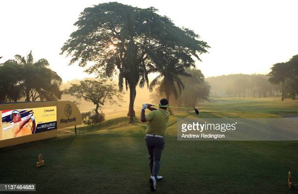 Prom Meesawat of Thailand hits his teeshot on the tenth hole on Day Two of the Maybank Championship at at Saujana Golf Country Club Palm Course on...