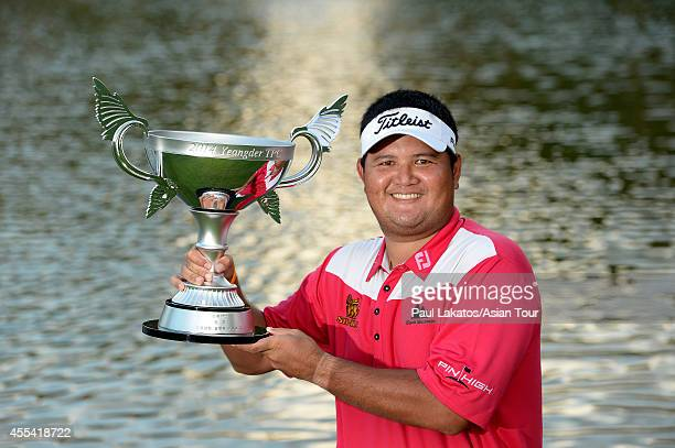 Prom Meesawat of Thailand pictured with the winner's trophy after a 2 hole play-off with Miguel Tabuena of the Philippines during round four of the...