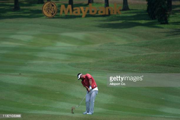 Prom Meesawat of Thailand plays on the 18th hole during Day Three of the Maybank Championship at Saujana Golf and Country Club on March 23 2019 in...