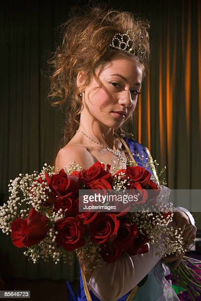 Prom queen posing with flowers