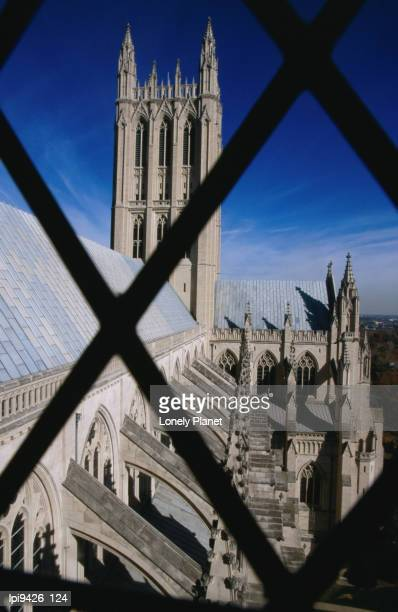 prom tower of national cathedral through window bars, washington dc, united states of america - flying buttress stock photos and pictures